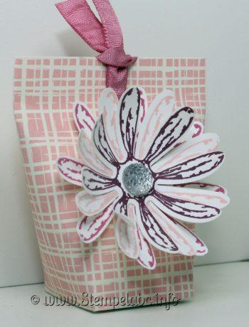Gänseblümchengruß auf Verpackung